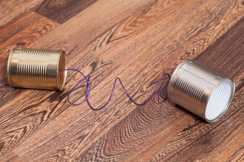 Tin Can Phone on Wooden Background.Communication concept